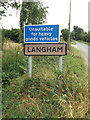 TL9770 : Langham Village Name sign on Stock Hill by Adrian Cable