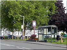 SK3030 : Bus shelter and Millennium sign by Graham Hogg