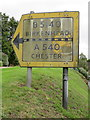 SJ2285 : A pre-Worboys road sign on the B5141 in Caldy by John S Turner