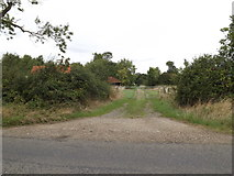 TM1387 : Entrance to Grange Farm by Adrian Cable