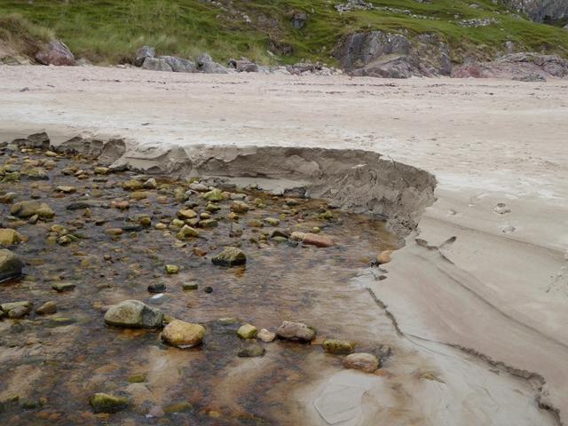 Stream erosion on the beach at Tràigh Allt Chàilgeag by Oliver Dixon