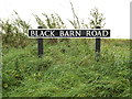 TM1189 : Black Barn Road sign by Adrian Cable