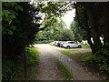 TM1192 : Entrance to All Saints Church car park by Geographer