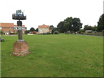 TM1686 : Green Lane & The Tivetshalls Village sign by Adrian Cable