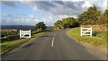 NZ0559 : New gates on western approach to New Ridley by Clive Nicholson