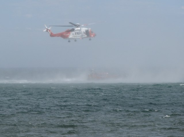 The combined spray generated by the Irish Coast Guard Rescue Helicopter and Newcastle's All Weather Lifeboat
