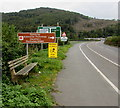 SH7401 : Roadside bench and signs alongside the A487 north of Machynlleth by Jaggery