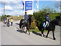 SP0057 : Horse riders passing entrance of new development by Jeff Gogarty