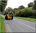 SH7400 : Hedge-trimming tractor on the A487 in Machynlleth by Jaggery