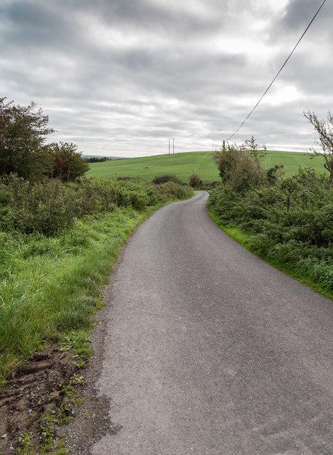 A twisty minor lane through farmland