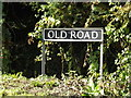TM1690 : Old Road sign by Adrian Cable