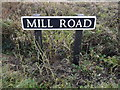 TM0993 : Mill Road sign by Adrian Cable
