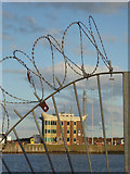 NT2677 : Port of Leith - Western Harbour through the fence by Chris Allen