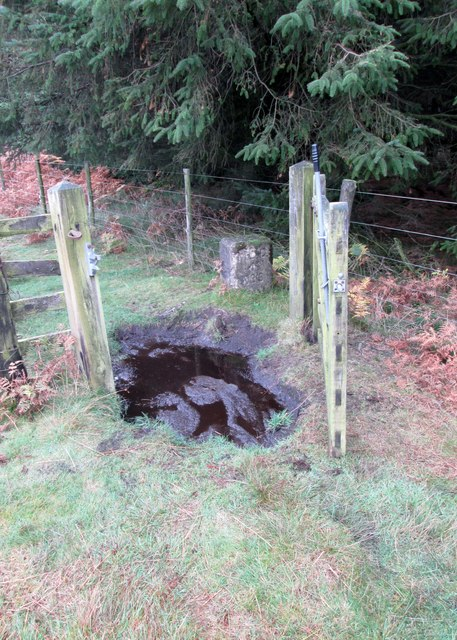 Bridleway  gate  with  MOD boundary stone beyond