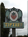 TL8916 : Tiptree Village sign by Adrian Cable
