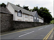 SH7400 : Houses behind a stone wall, Machynlleth by Jaggery