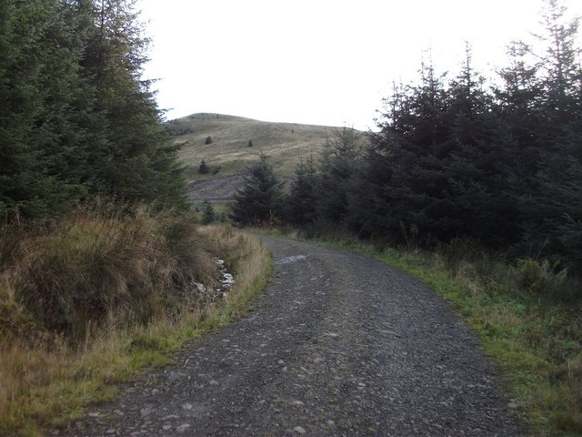 first sighting of Meikle Bin from path in Carron Valley Forest