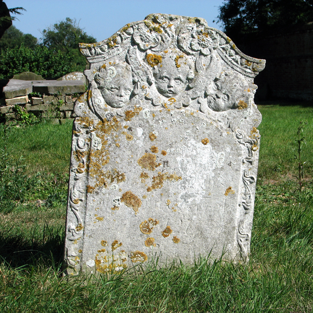Old gravestone in All Saints' churchyard