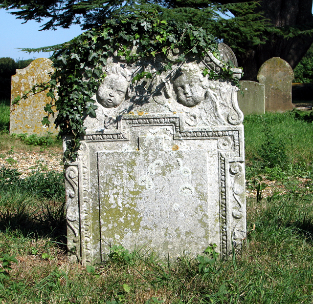 Ivy-clad headstone in All Saints' churchyard