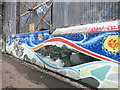 TQ1777 : Canal Mural under the Covered Dock by Des Blenkinsopp