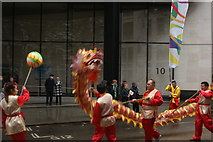TQ3281 : View of a Chinese dragon in the Lord Mayor's Parade from Gresham Street by Robert Lamb