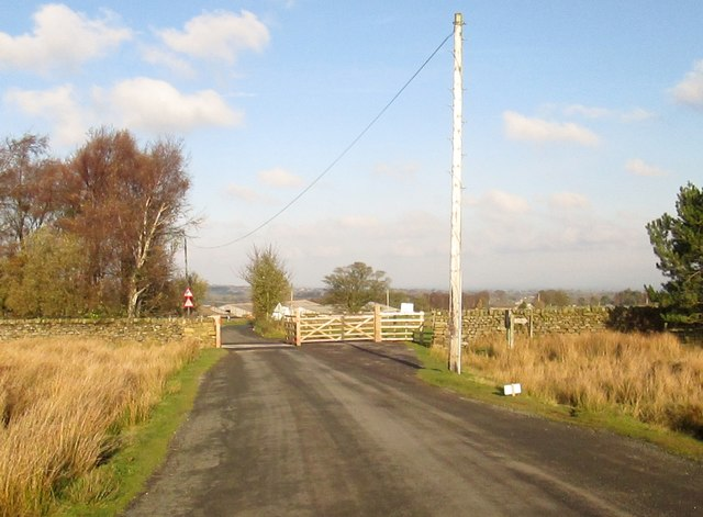 Exiting  open  moorland  Cattle  grid  and  gate  for  horses