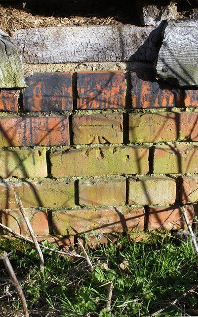 Benchmark on barn at Edneys Hill Farm