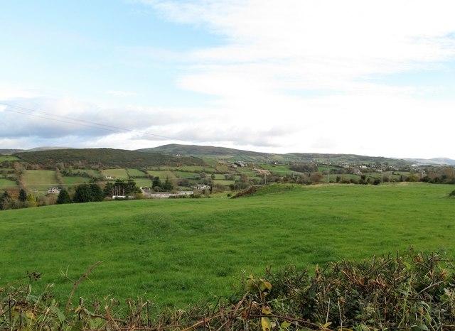 View across pasture land towards the Grinan Trough
