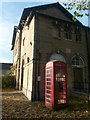 SP3103 : Bampton: telephone box in the Market Square by Chris Downer