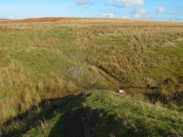 Geological dyke crossing a stream valley