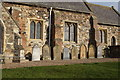 TA1242 : Gravestones at St Margaret's Church, Long Riston by Ian S