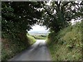 NZ0958 : Country lane junction by Robert Graham
