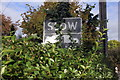 SJ2977 : Old Road Sign on Station Road, Neston by Jeff Buck