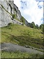 SD8964 : The eastern end of the cliff at Malham Cove by David Smith