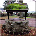 ST3794 : Inscription on a well in the centre of Tredunnock by Jaggery