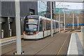 NT1772 : An Edinburgh Tram leaving the Edinburgh Gateway tram stop by Garry Cornes