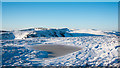NY3908 : Frozen and snowed pool near to summit of Red Screes by Trevor Littlewood
