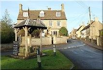 ST8080 : Well and village street, Acton Turville by Derek Harper
