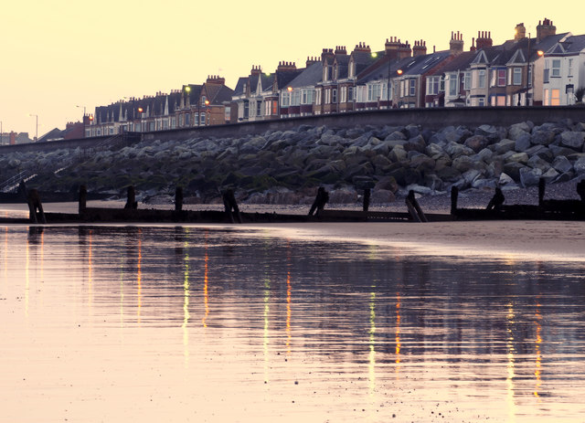 Withernsea Seafront Houses Sand Reflection