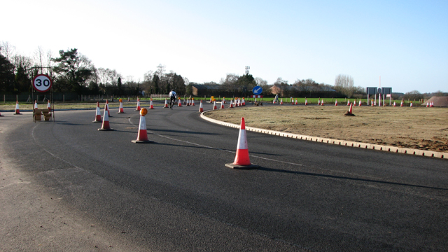 Cyclist on Fir Covert roundabout