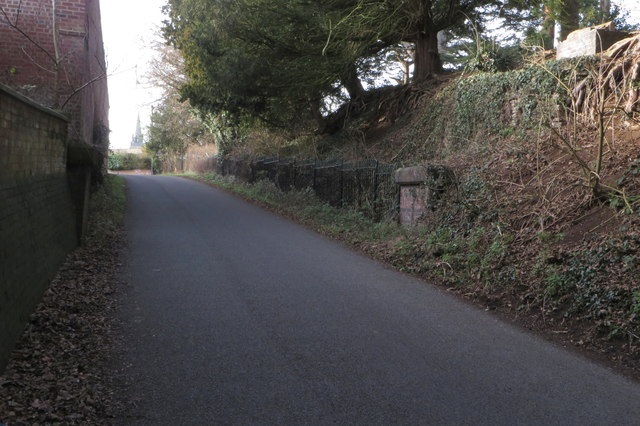 Road past Dunstall Hall with the church in the distance