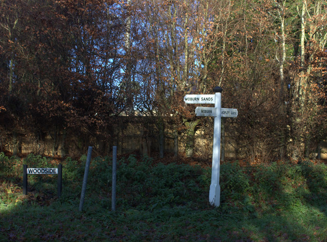 Signpost at the junction of Aspley Lane and Woodside