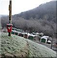 ST2293 : Red bin on a wooden pole, Cwmcarn by Jaggery