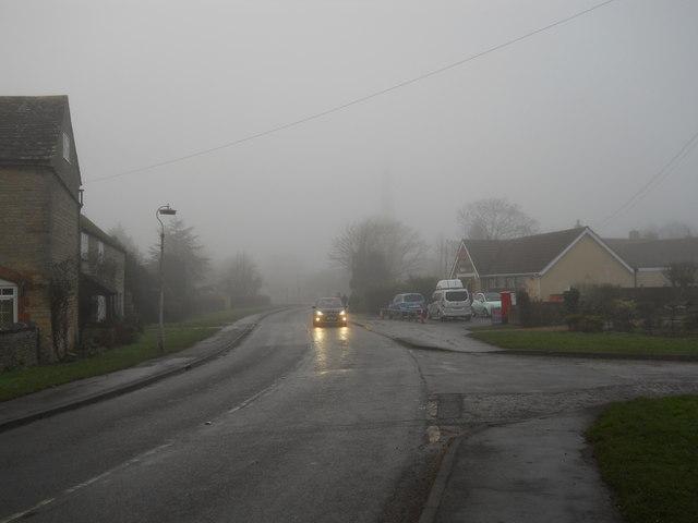 High Street, Glinton, on a foggy day