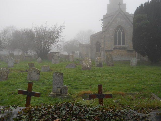 St. Benedict's Church and churchyard, Glinton, on a foggy day