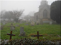 TF1505 : St. Benedict's Church and churchyard, Glinton, on a foggy day by Paul Bryan