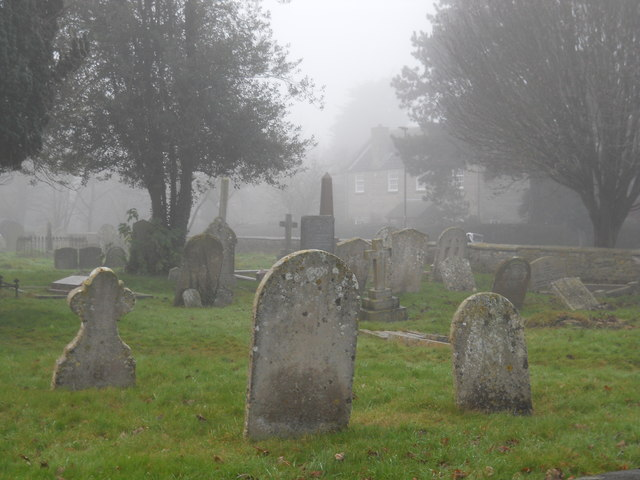 Graveyard at St. Benedict's Church, Glinton, on a foggy day