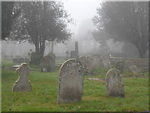 TF1505 : Graveyard at St. Benedict's Church, Glinton, on a foggy day by Paul Bryan