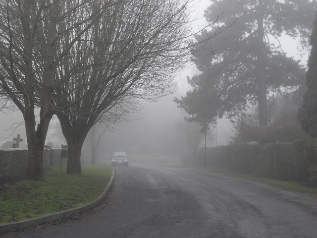 The Green, Glinton, on a foggy day