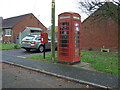 SJ5556 : Elizabeth II postbox and telephone box on South Croft, Spurstow by JThomas